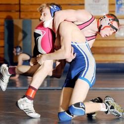 Jake Thornton (left) of Mountain Valley wrestles Robert Banner of Ellsworth during a 126-pound match at Mountain Valley High School during the McDonald's Invitational in Rumford on Saturday. Thornton won the match, but Ellsworth went on to win the team title.