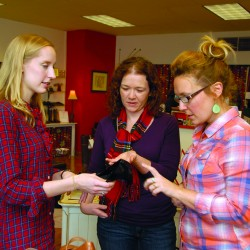 Taking advantage of Plaid Friday sales at Valentine Footwear on Main Street in Bangor, Morgan Cashwell (center) of Linthicum, Md. checks out a Born Sabrina black comfort pump while talking with store employees Emily Hanna (left) and Meg Gipson in late November.