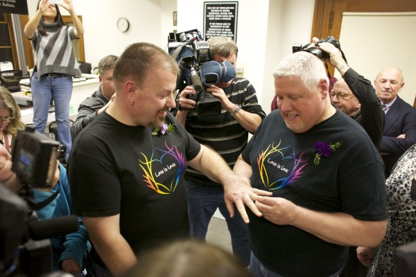 Steven Bridges and Michael Snell exchange rings after getting married at Portland City Hall on Dec. 29, 2012. Bridges and Snell were the first same-sex couple to be married in Portland.