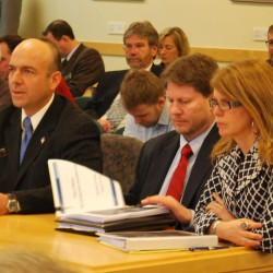 Gary Alexander (from left) and Eric Randolph of Rhode Island-based Alexander Group and Maine Department of Health and Human Services Commissioner Mary Mayhew prepare Tuesday to answer questions from the Health and Human Services Committee in Augusta.
