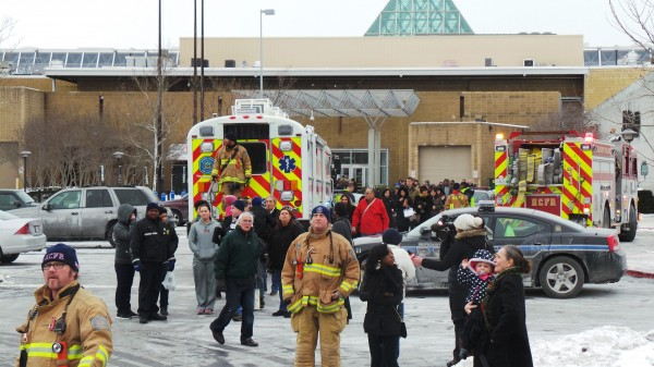Emergency personnel escort people out  of a mall in Columbia, Md., Saturday after three people were killed in a shooting incident. One of the dead was believed to be the shooter, police said.