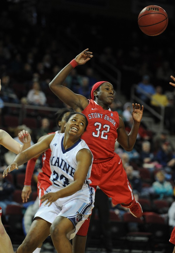 Maine's Ashleigh Roberts has a rebound slapped away from her by Stony Brook's Chikilra Goodman at the Cross Insurance Center on Sunday.