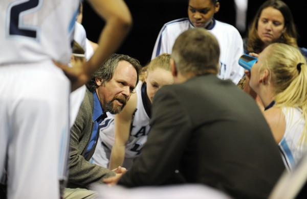 Maine women's basketball head coach Richard Barron talks with his team during a timeout on Sunday at the Cross Insurance Center.