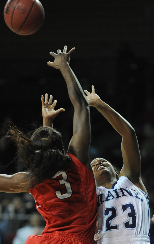 Maine's Ashleigh Roberts has her shot blocked by Stony Brook's Jessica Ogunnorin at the Cross Insurance Center on Sunday. Stony Brook won 65-49.