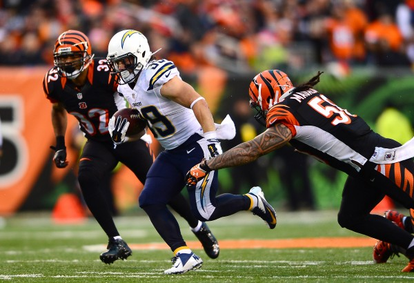 San Diego Chargers running back Danny Woodhead (39) runs the ball away from Cincinnati Bengals linebacker Emmanuel Lamur (59) during third quarter of an AFC wild card playoff football game at Paul Brown Stadium in Cincinnati Sunday.