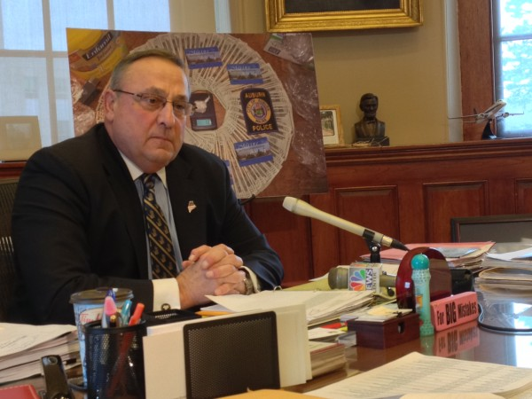 Gov. Paul LePage speaks with reporters from his office in the State House on Thursday, Dec. 19 2013.