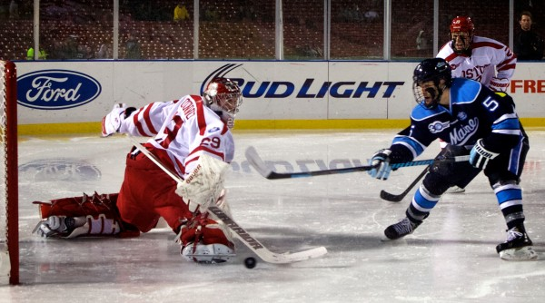 University of Maine hockey's Andrew Cerretani scores a goal against Boston University Saturday in the first period at Fenway Park in Boston. Maine went on to win by a score of 7-3.