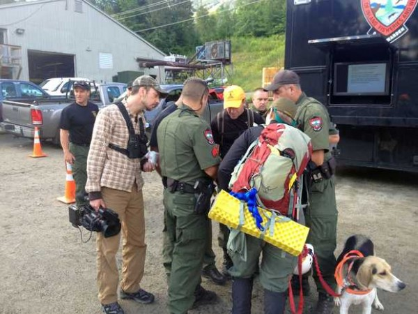 Members of the Maine Warden Service and volunteers gather July 30, 2013, at the command post at Sugarloaf to prepare for another day of searching for missing Appalachian Trail hiker Geraldine Largay.