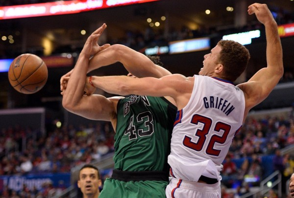 Los Angeles Clippers power forward Blake Griffin (32) fouls Boston Celtics power forward Kris Humphries (43) while battling for a rebound during second half action at Staples Center in Los Angeles Wednesday night.