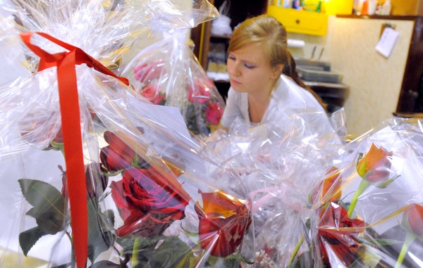 Lisa Subjoc gathers orders of bouquets at Bangor Floral on Thursday.