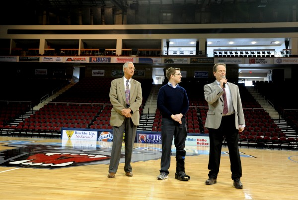 Mike Dyer (from right), general manager of the Cross Insurance Center; Bangor City Council Chairman Ben Sprague and Jerry Goss, co-director of the Eastern Maine High School Basketball Tournament, speak at a Thursday press conference beforethe Friday start of the 2014 basketball tournament  at the Cross Insurance Center.