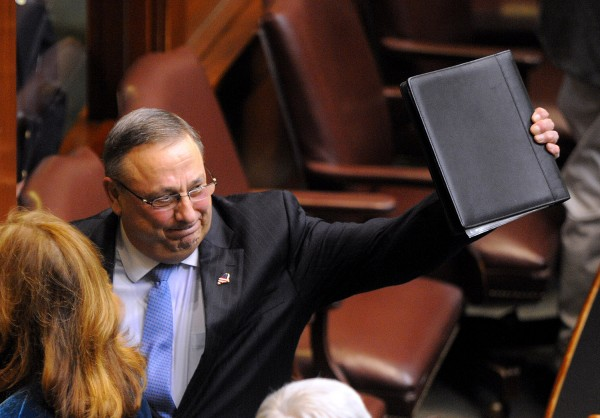 Governor Paul LePage waves as he leaves the House of Representatives chamber after he delivered his 2014 State of the State address at the State House in Augusta on Feb. 4, 2014.