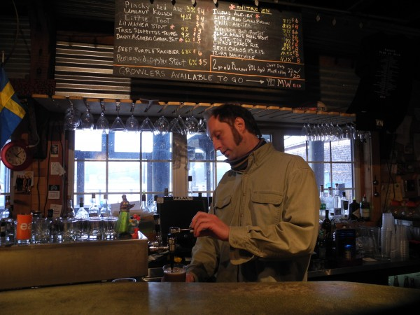 David Carlson, the owner of Three Tides in Belfast, poured a Sea Level Stout before the bar's opening party on St. Patrick's Day in this March 2012 file photo.