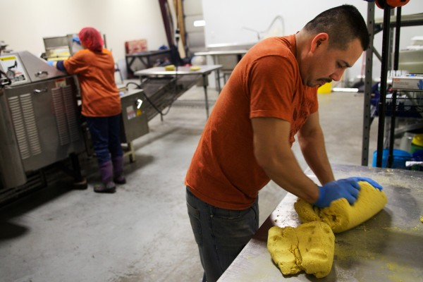 Gustavo Rodriguez kneads masa, a mixture of corn, water and lime, before feeding it into a tortilla baking machine at Tortilleria Pachanga in Portland on Thursday morning.