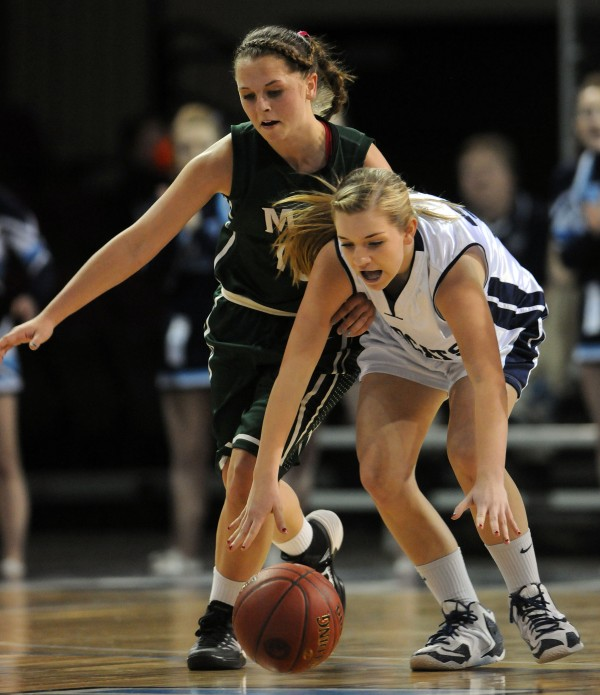 MDI's Molly Carroll and Presque Isle's Taylor Williams chase down a loose ball on Saturday during Eastern Maine Class B action at the Cross Insurance Center in Bangor.