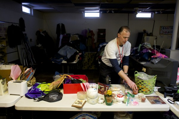 Alan Cunningham of Bangor organizes the thrift shop downstairs at The Together Place in Bangor.