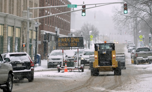 Parking ban signs are out in downtown Bangor for Wednesday night.