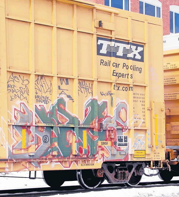Part of a Pan Am Railways train headed north alongside Front Street in Bangor on Feb. 10, a TTX box car displays prime examples of railroad art.