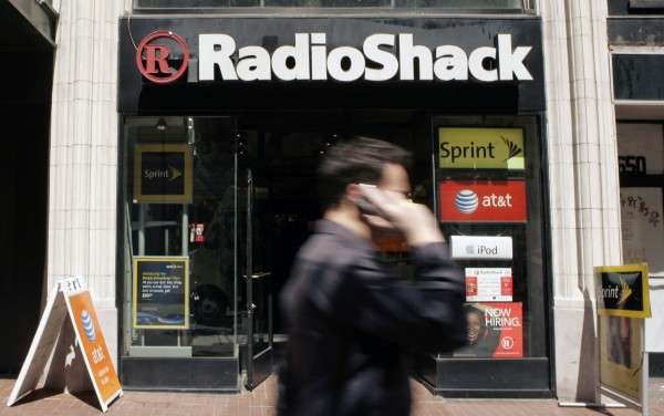 A man walks past a RadioShack retail store on Market Street in San Francisco, California in this file photo taken April 28, 2008.
