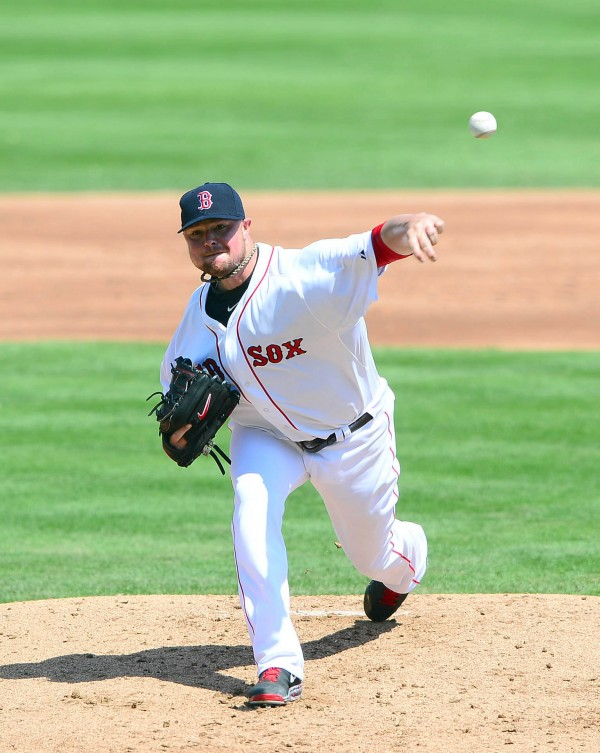 Boston Red Sox pitcher Jon Lester delivers a pitch against the Tampa Bay Rays during a spring training game on March 10 in Fort Myers, Fla. Lester will start Boston's opener against the Orioles at 3:05 p.m. Monday in Baltimore.