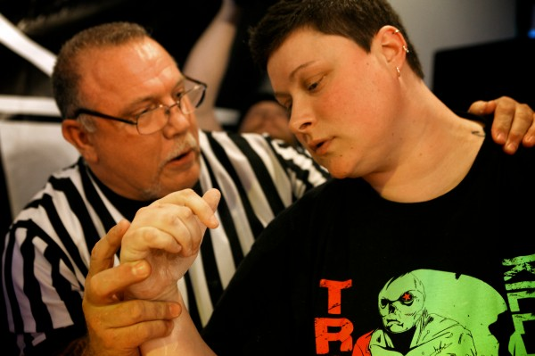 Five-time world arm wrestling champion and referee Art &quotBadger&quot Drewes gives a few pointers to Devin Jewett of Topsham Saturday after her first match at the  2014 Maine State Armwrestling Championship in South Portland.