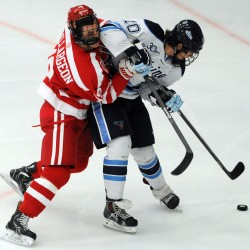 UMaine's Ben Hutton (right) and Boston University's Robbie Baillargeon battle for control of the puck during a game in November in Orono. Hutton leads the nation's defensemen with goals entering this weekend's quarterfinal playoff series at Providence College.