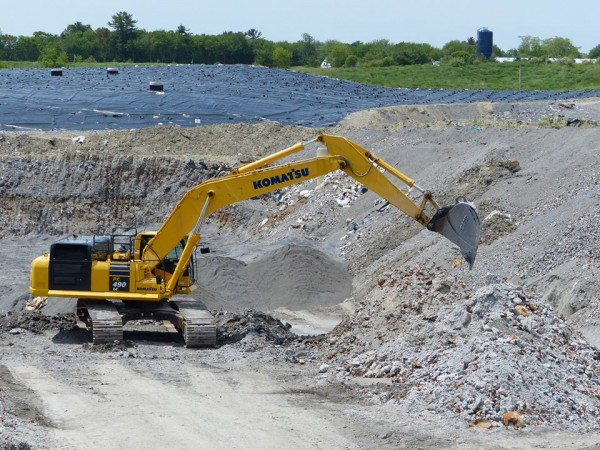 In this March 2014 file photo, heavy equipment digs through ash at ecomaine's southern Maine landfill.
