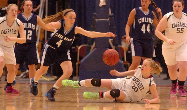 Calais High School's Madison McVicar (4) presses for a loose ball against Carrabec High School's Hannah Atwood (20) during the girls Class C state championship basketball game Saturday night in the Augusta Civic Center.