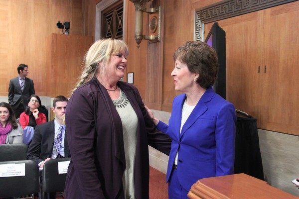 Sen. Susan Collins (right) speaks with Dixie Shaw of Catholic Charities Maine on Wednesday prior to a hearing on elder poverty in the Senate Special Committee on Aging.