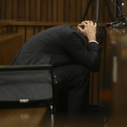 'Blade Runner' Oscar Pistorius sobs during court appearance on murder charge