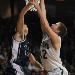Old Town's Adam Richadson has his shot blocked by Poland's Josh Gary during the Class B state championship game on Friday night at the Cross Insurance Center in Bangor. Old Town won 64-39.