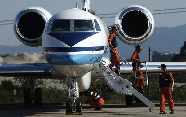 Japan Coast Guard personnel prepare their Gulfstream V Jet aircraft, customized for search and rescue operations, to search for the missing Malaysia Airlines MH370 plane over the waters of the South China Sea on Saturday.