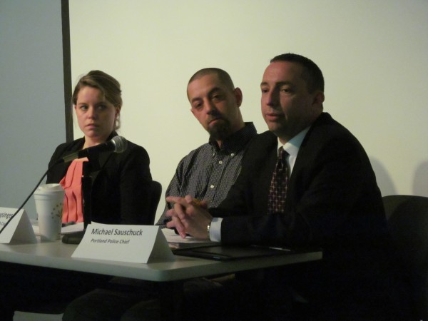 Portland Police Chief Michael Sauschuck (right) discusses marijuana use in the city during a panel discussion Wednesday night at the Portland Public Library. Fellow panelists Mike Freysinger of Maine Youth Court and Grainne Dunne of the American Civil Liberties Union look on.