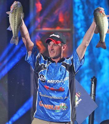 Jonathan Carter of Orrington holds up fish he caught during the 2013 Bassmaster Classic in Oklahoma. Carter finished in 17th place.