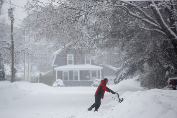 Bangor residents cleared off their cars and removed several inches of snow from their driveways after another storm brought 11 inches of snow to the area in this March 2014 file photo.