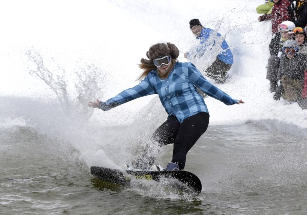 A snowboarder appears to attempt carving a turn during the Slush Cup at Shawnee Peak on Saturday.