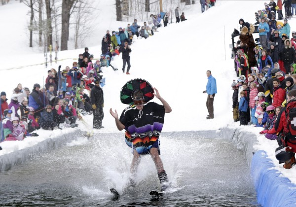 George Farah of Yarmouth, Mass., reaches for his sombrero moments before crashing into the water at Shawnee Peak on Saturday.