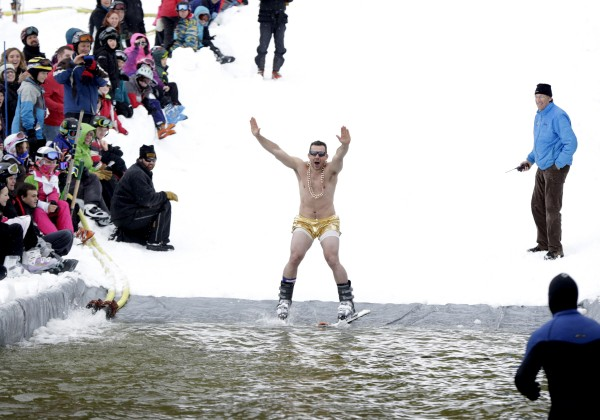 Albi Skendri from Albania arrives at the edge of the pond, dressed like someone who plans on getting wet during the Slush Cup at Shawnee Peak on Saturday.