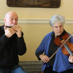 Ray Lambert and Elaine Malkin performed Quebecois tunes in the Hall of Flags.