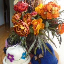 Phyllis Michaud of Orrington knitted these felted hats, one decorated with a floral design, the other sporting a butterfly. She knits many hats each year.