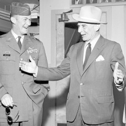 At Dow Air Force Base in Bangor in 1954, Gen. Jimmy Doolittle (right) shows Lt. Col. James Wiley the size of the salmon that Doolittle caught at the Miramichi River at Blackville, New Brunswick. Doolittle stopped over at Dow before heading for Grand Lake for more fishing.