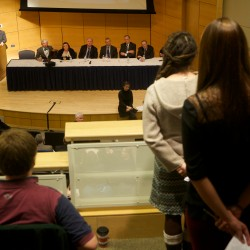 University of Southern Maine President Theo Kalikow (at the podium) listens to questions at an all-campus forum in Portland dealing with proposed dramatic restructuring and program cuts at the school.