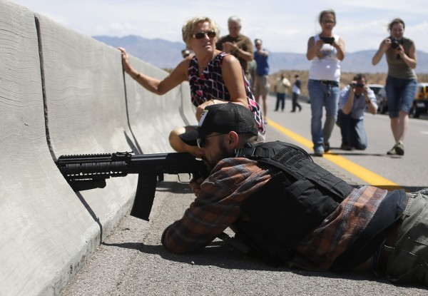 Protester Eric Parker from central Idaho aims his weapon from a bridge next to the Bureau of Land Management's base camp where seized cattle, that belonged to rancher Cliven Bundy, are being held at near Bunkerville, Nevada April 12, 2014.