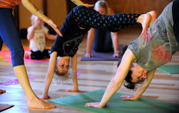 Sandy Feher (right) brought her daughter Emily Feher, 8, (left) to the Kids's Matis Yoga calss tought by Holly Twining at the OmLand Yoga studio in Orono.