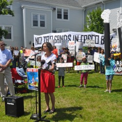 Maura McDonald, a nurse practioner and South Portland resident, speaks on Thurs., June 6, 2013, at a rally organized by the Concerned Citizens of South Portland against the prospect of pumping oil sand crude, also known as tar sands, from Montreal to South Portland harbor.