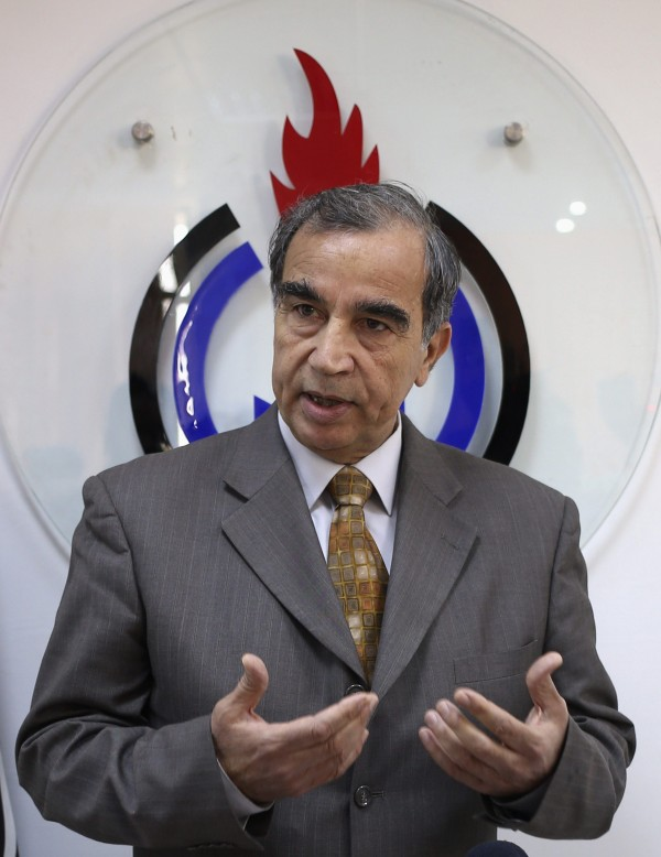Libya's acting Oil Minister Omar Shakmak gestures as he speaks during a news conference in Benghazi April 3.