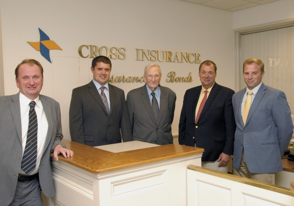 Representing three generations of the Cross family at the Cross Insurance Co. in Bangor are (from left) Royce Cross, Jonathan Cross, Woodrow Cross, Brent Cross, and Woodrow Cross II in this August 2013 file photo.