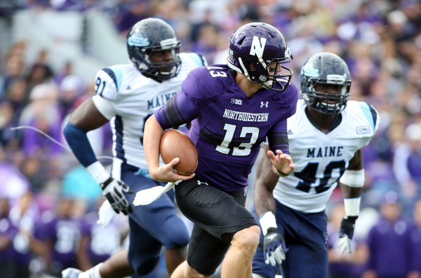Northwestern Wildcats quarterback Trevor Siemian (center) runs away from Maine Black Bears defensive lineman Jonathan Lewis (left) and linebacker Christophe Mulumba Tshimanga during the second quarter at Ryan Field in this September 2013 file photo.