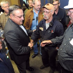 Gov. Paul LePage (second from left) shakes hands with employees at Great Northern Paper company in East-Millinocket after a press conference in Oct. 2011.