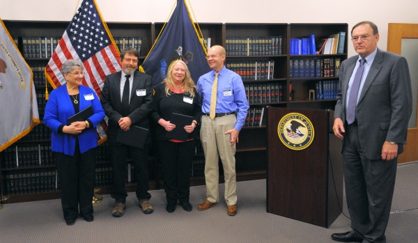 U.S. Attorney Thomas Delahanty II (right) gave awards of recognition to (from left) Marjorie Withers, director of Community Caring Collaborative; Skip Gates; Sally Tardiff, executive director of the Shaw House; and former Bangor Police Chief Don Winslow. The ceremony was held at the Margaret Chase Smith Federal Building in Bangor to commemorate Crime Victims Rights Week and Child Abuse Prevention Month.